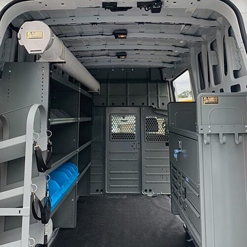 "Creative installation of 6"" PVC interior on a Nissan High Roof.  Adrian Steele HVAC Package featuring open shelving and divider, bins, and drawer storage options.  #adrainsteele #cargovan #upfit #workvan"